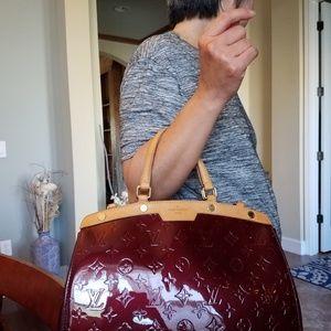 Authentic Louis Vuitton Amarante Brea PM Handbag